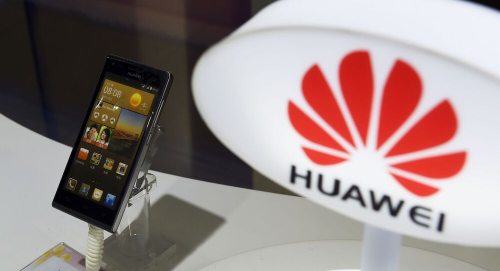 A mobile phone made by Chinese telecom equipment maker Huawei is displayed in a store in Beijing on August 3, 2015. Two Chinese smartphone makers pushed US technology giant Apple into third place in the world's biggest market in the second quarter, an independent analyst firm said on August 3.