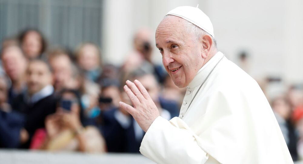 Pope Francis greets people as he arrives for the weekly general audience at the Vatican; 30 October 2019.