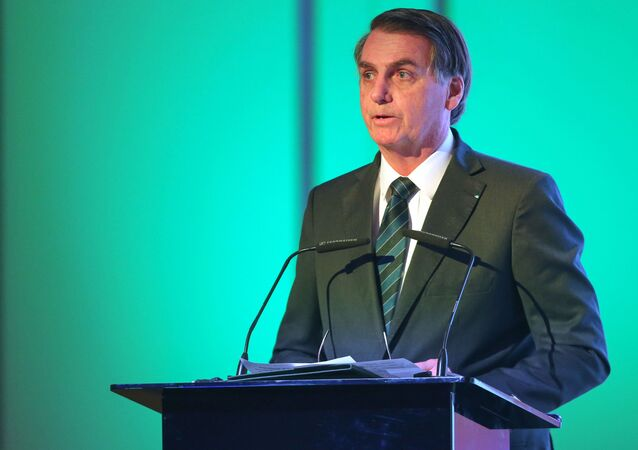 Brazilian President Jair Bolsonaro speaks during the Brazil-United Arab Emirates Business Forum in the Emirati capital Abu Dhabi, on October 27, 2019.