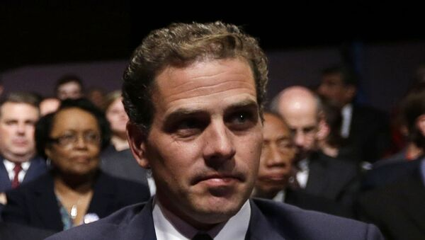 In this Oct. 11, 2012, file photo, Hunter Biden waits for the start of the his father's, Vice President Joe Biden's, debate at Centre College in Danville, Ky. In 2014, then-Vice President Joe Biden was at the forefront of American diplomatic efforts to support Ukraine's fragile democratic government as it sought to fend off Russian aggression and root out corruption. So it raised eyebrows when Biden's son Hunter was hired by a Ukrainian gas company. President Donald Trump prodded Ukraine's president to help him investigate any corruption related to Joe Biden, now one of the top Democrats seeking to defeat Trump in 2020. - Sputnik International