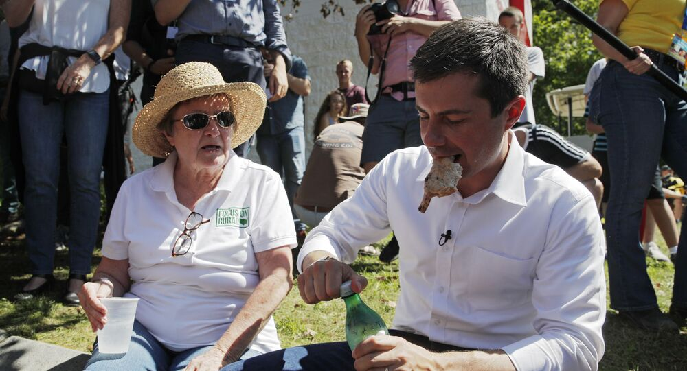 Democratic presidential candidate South Bend Mayor Pete Buttigieg eats a pork chop at the Iowa State Fair, Tuesday, Aug. 13, 2019, in Des Moines, Iowa.