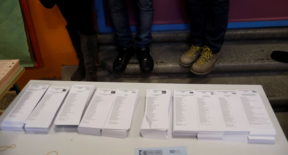 Photographers take pictures of ballots in a polling station ahead of general election in Madrid, Spain November 9, 2019. REUTERS/Jon Nazca