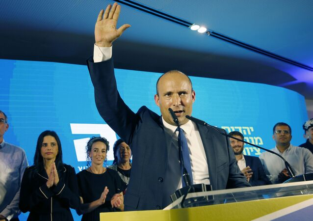 Naftali Bennett (C), member and candidate for the New Right party that is part of the Yamina political alliance, speaks while flanked by party leader Ayelet Shaked (2nd-L), Yamina candidate Ofir Sofer (2nd-R), and and Tkuma party leader and candidate Bezalel Smotrich (3rd-R), at the alliance's headquarters in Ramat Gan, north of Tel Aviv, late on September 17, 2019, as the first exit polls are announced on television. - Israeli Prime Minister Benjamin Netanyahu and his main challenger Benny Gantz were neck-and-neck in the country's general election after polls closed, exit surveys showed. Three separate exit polls carried by Israeli television stations showed Netanyahu's right-wing Likud and Gantz's centrist Blue and White alliance with between 31 and 34 parliament seats each out of 120.