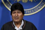 Bolivia's President Evo Morales looks on during a press conference in La Paz, Bolivia, Sunday, Nov. 10, 2019. Morales is calling for new presidential elections and an overhaul of the electoral system Sunday after a preliminary report by the Organization of American States found irregularities in the Oct. 20 elections.
