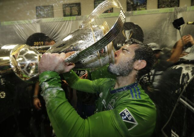 Seattle Sounders' Victor Rodriguez, who scored a goal in the match, drinks from the cup Sunday, Nov. 10, 2019, after defeating Toronto FC in the MLS Cup championship soccer match in Seattle.