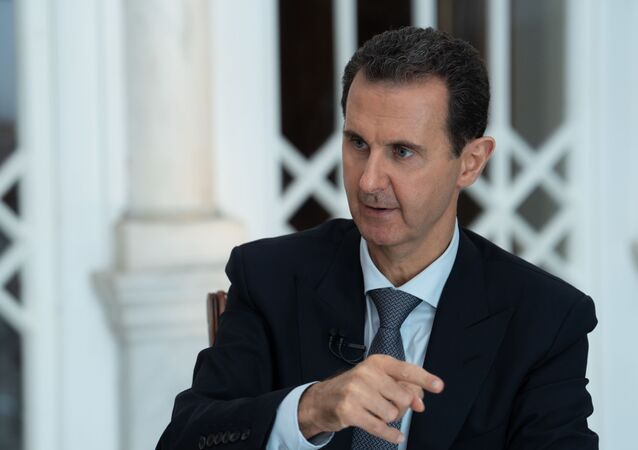A handout picture released by the official Syrian Arab News Agency (SANA) on October 31, 2019 shows President Bashar al-Assad speaking during a special broadcast interview in Syria's capital Damascus.