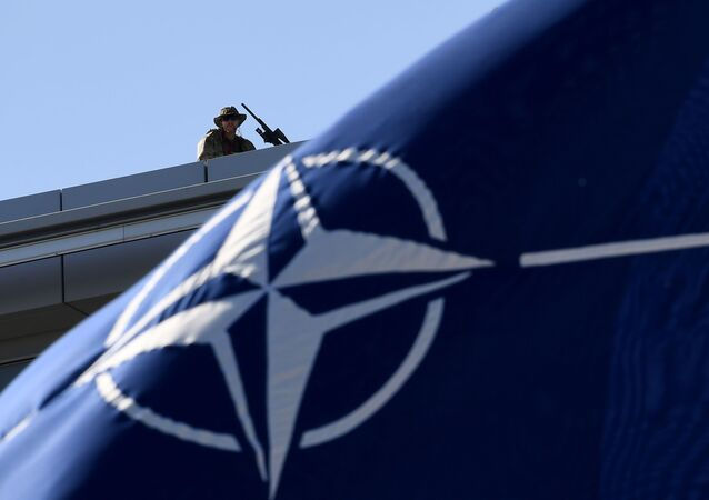 Military personnel stand guard on top of the roof during the NATO (North Atlantic Treaty Organisation) summit ceremony at NATO headquarters in Brussels on 25 May 2017