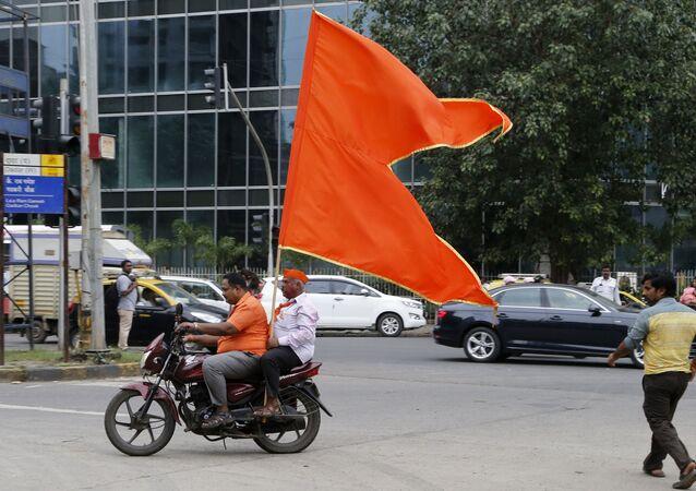 Shiv Sena party supporters celebrate in Mumbai, India, Thursday, Oct. 24, 2019
