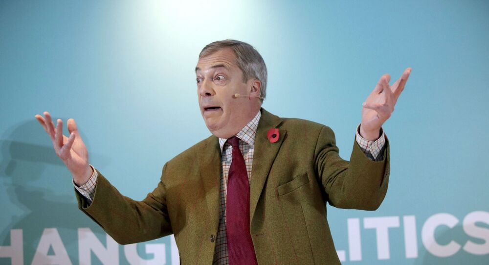 Brexit Party leader Nigel Farage gestures as he delivers a speech to supporters, during an event at the Washington Central Hotel, in Workington, England, Wednesday, Nov. 6, 2019