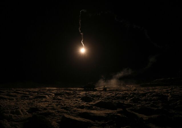 A lit flare streaks through the sky during a night exercise conducted by the Combat Support Squadron of the First Battalion of the Northern Brigade of the Norwegian Army during Reindeer 2, a Norwegian-U.S. military drill in Setermoen, Norway, October 30, 2019