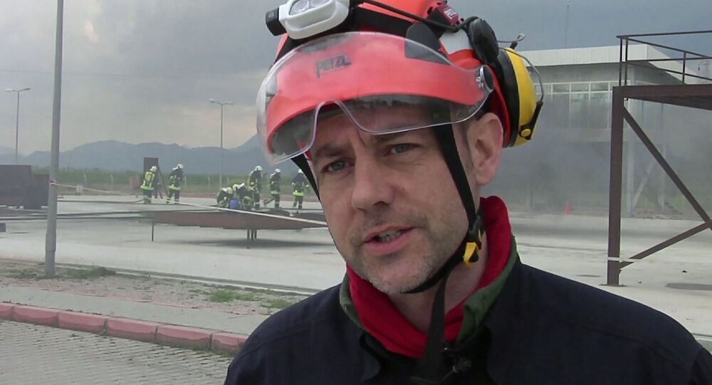 FILE - In this image taken from file video, showing James Le Mesurier, founder and director of Mayday Rescue, talks to the media during training exercises in southern Turkey, March 19, 2015
