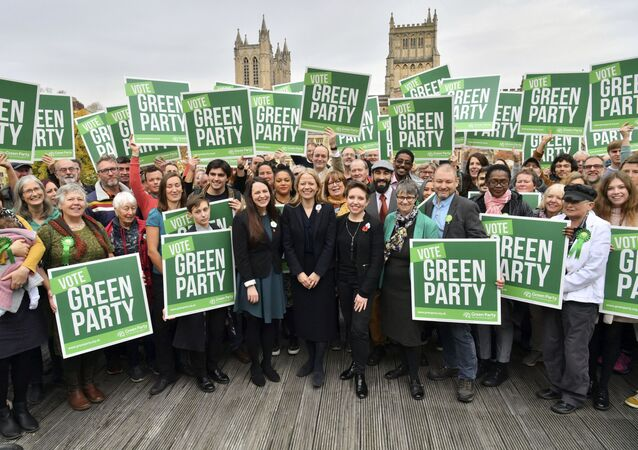 Britain's Green Party co-Leader Sian Berry (centre) launch the party's general election manifesto in Bristol on 6 November 2019