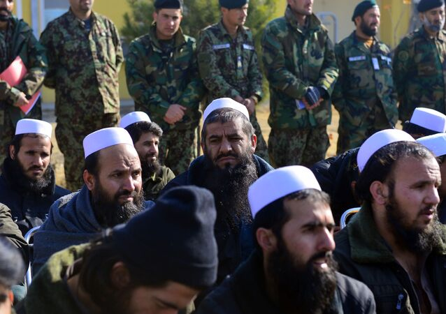 Released Taliban prisoners sit on chairs as they listen during a ceremony in Pul-e-Charkhi jail on the outskirts of Kabul on January 4, 2013
