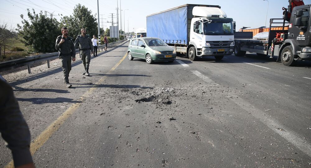 Israeli police block the road moments after a rocket fired by Palestinians militants from Gaza hit a main free way between Ashdod and Tel Aviv near Ashdod Israel, Tuesday, Nov. 12, 2019