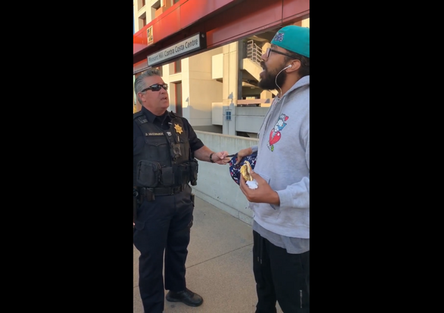 A BART officer from California is seen in cellphone footage confronting transit rider Steve Foster over his decision to eat a breakfast sandwich on the train platform, which is a citable offense per the state's law.