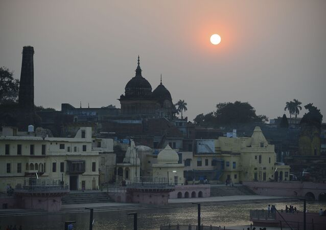 Devotees walk at Ram ki paidi Ghat during sunset on the eve of Kartik Purnima celebrations near Saryu river in Ayodhya on November 11, 2019, after Supreme Court verdict on the disputed religious site.
