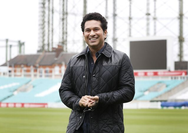 Indian former cricket player Sachin Tendulkar smiles as he walks around the pitch at the Oval cricket ground to promote his upcoming film, in London, Saturday, 6 May 2017