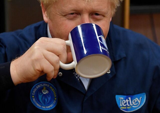 Britain's Prime Minister Boris Johnson reacts as he drinks a cup of tea during a general election campaign visit to the Tetley Tea Factory at Tata Global Beverages in Stockton-on-Tees, Britain November 7, 2019