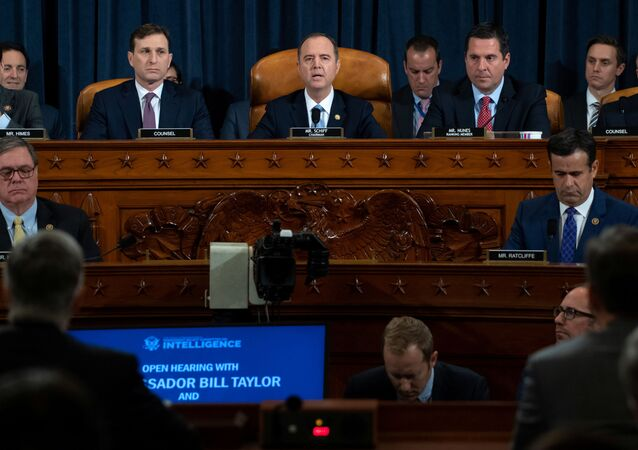 Chairman Adam Schiff (C), Democrat of California, gives an opening statement during the first public hearings held by the House Permanent Select Committee on Intelligence as part of the impeachment inquiry into U.S. President Donald Trump
