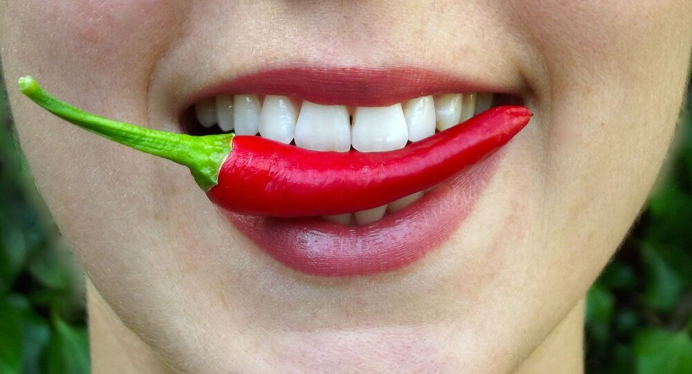 Chili pepper in mouth