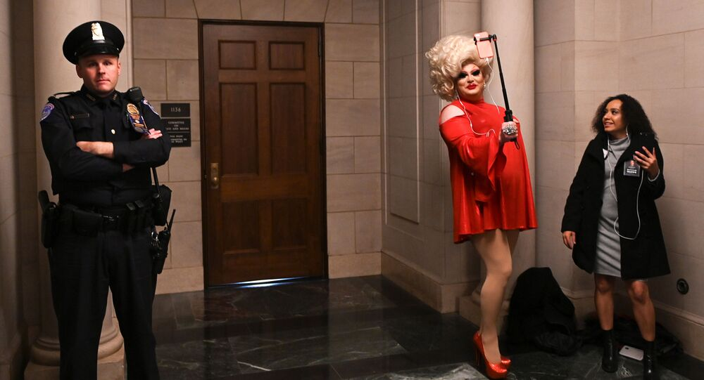 Drag queen Pissi Myles poses in a hallway near the House Intelligence Committee hearing of the impeachment inquiry into U.S. President Donald Trump on Capitol Hill in Washington, U.S., November 13, 2019
