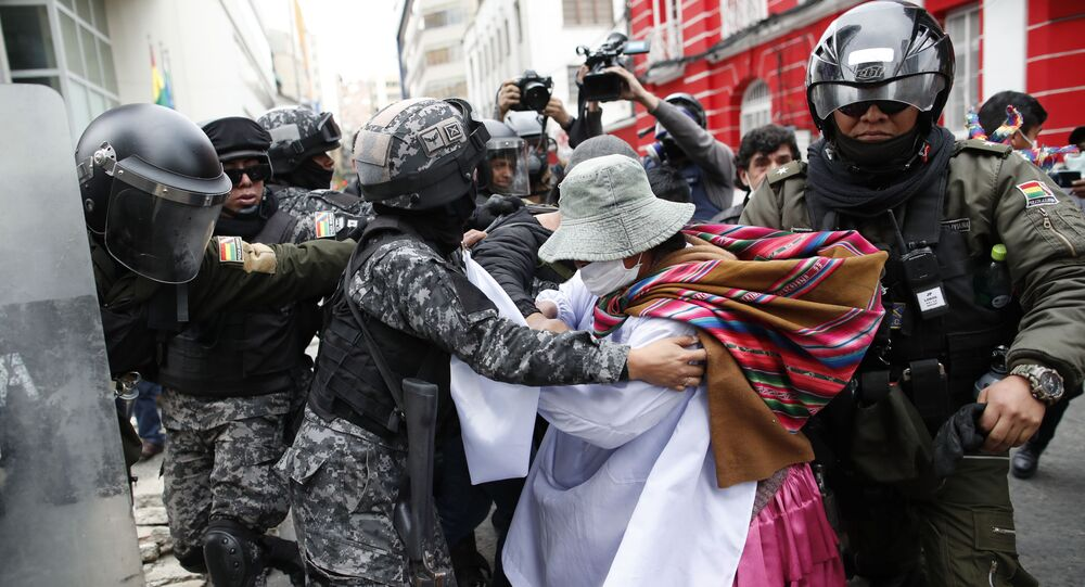 A backer of former President Evo Morales scuffles with police in La Paz, Bolivia, 13 November 2019. The opposition senator who has claimed Bolivia's presidency, Jeanine Anez, faces the challenge of stabilising the nation and organising national elections within three months at a time of political disputes that have prompted Morales to seek self-exile in Mexico after 14 years in power. (AP Photo/Natacha Pisarenko)
