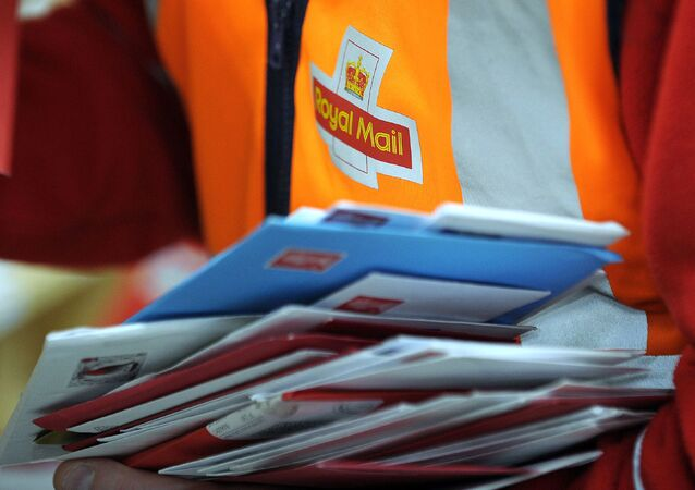 (FILES) In this file photo taken on December 15, 2016, a worker is pictured sorting post at the Royal Mail Distribution centre in Glasgow. - Royal Mail on November 8, 2019