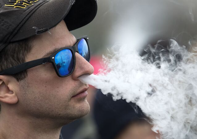 Demonstrator vapes outside of the White House