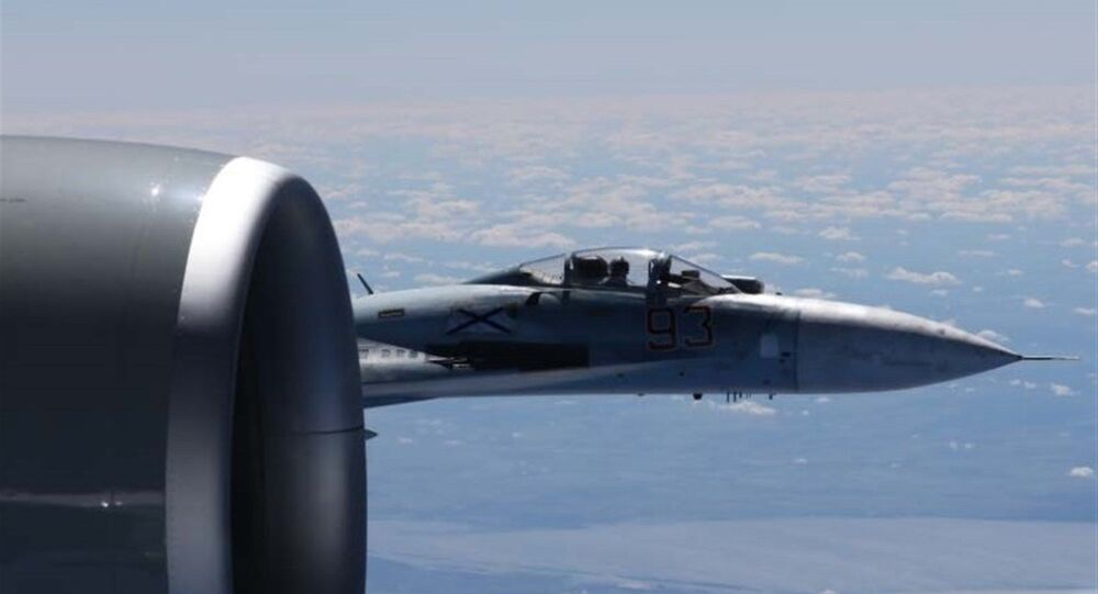 Russian jet and US Air Force reconnaissance jet over the Baltic Sea