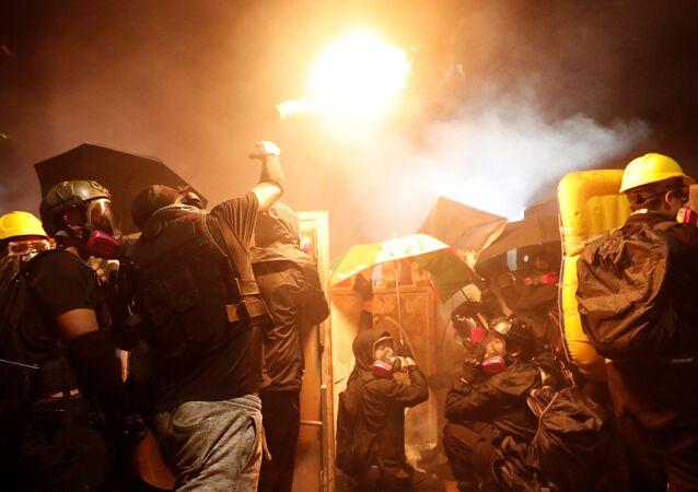 A protesters throws a molotov cocktail during a standoff with riot police at the Chinese University of Hong Kong, Hong Kong, China November 12, 2019