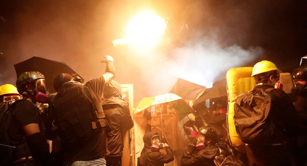 A protesters throws a molotov cocktail during a standoff with riot police at the Chinese University of Hong Kong, Hong Kong, China November 12, 2019