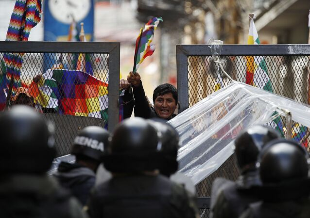 Police block supporters of former President Evo Morales from entering the area of Congress in La Paz, Bolivia, Tuesday, Nov. 12, 2019.