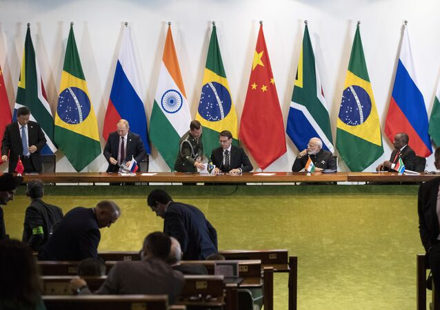 China's President Xi Jinping, left, Russia's President Vladimir Putin, second from left, Brazil's President Jair Bolsonaro, center, India's Prime Minister Narendra Modi, second from right, and South Africa's President Cyril Ramaphosa leave after a meeting with members of the Business Council and management of the New Development Bank during the BRICS emerging economies at the Itamaraty palace in Brasilia, Brazil, Thursday, Nov. 14, 2019.