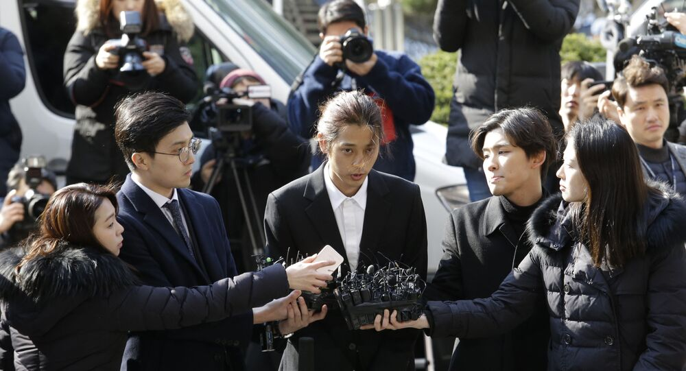 K-pop singer Jung Joon-young speaks upon his arrival at the Seoul Metropolitan Police Agency in Seoul, South Korea