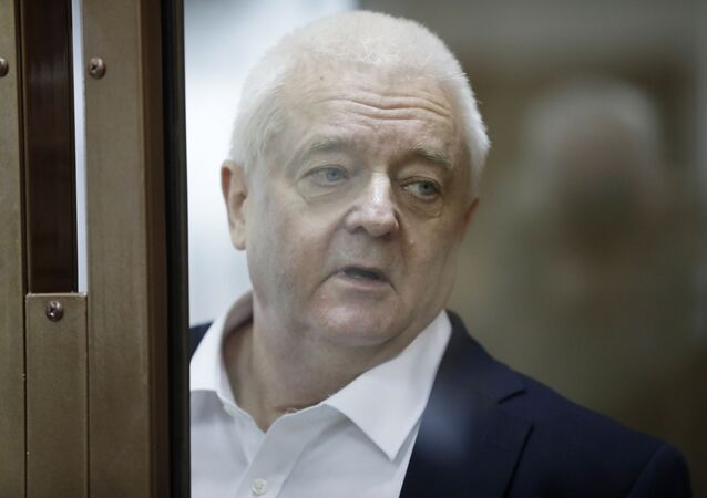 Norwegian national Frode Berg, who is accused of spying on Russia, stands inside a glass cage in a court room in Moscow, Russia, Tuesday, April 16, 2019