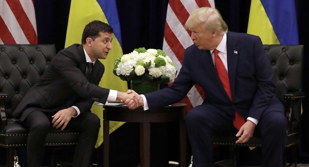 FILE - In this Sept. 25, 2019, file photo, President Donald Trump meets with Ukrainian President Volodymyr Zelenskiy at the InterContinental Barclay New York hotel during the United Nations General Assembly in New York. From the moment he was elected, Zelenskiy pushed for an Oval Office meeting with President Donald Trump