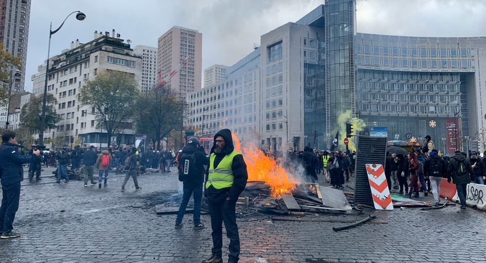 French police use tear gas as yellow vests return to Paris By