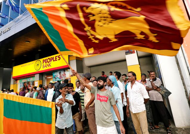 People celebrate after the voting ended during the presidential election day in Colombo, Sri Lanka November 16, 2019. REUTERS/Dinuka Liyanawatte