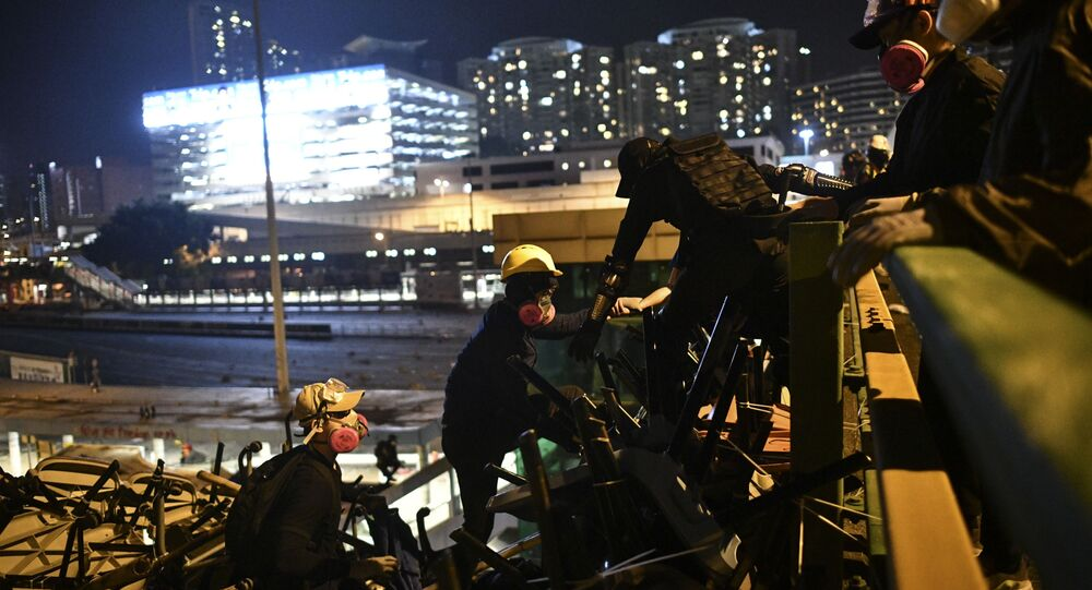 Protestors climb to a highway bridge leading to Cross Harbour Tunnel during clashes with police outside the Polytechnic University of Hong Kong in Hung Hom district of Hong Kong on November 16, 2019.