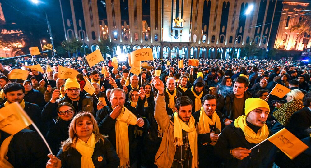 Georgian opposition supporters attend a rally outside the parliament in central Tbilisi on November 14, 2019.