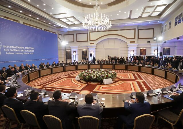 Delegations of Russia, Iran and Turkey at a hotel in Astana, Kazakhstan