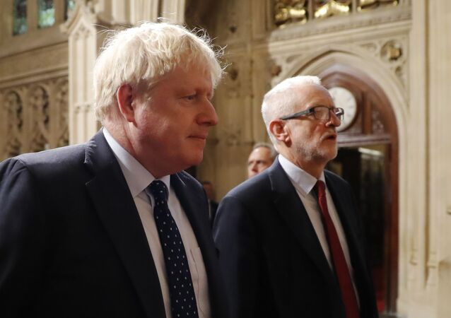 Britain's Prime Minister Boris Johnson (L) and main opposition Labour Party leader Jeremy Corbyn (R) head the procession of members of parliament through the Peers Lobby into the House of Lords to listen to the Queen's Speech during the State Opening of Parliament in the Houses of Parliament in London on 14 October 2019