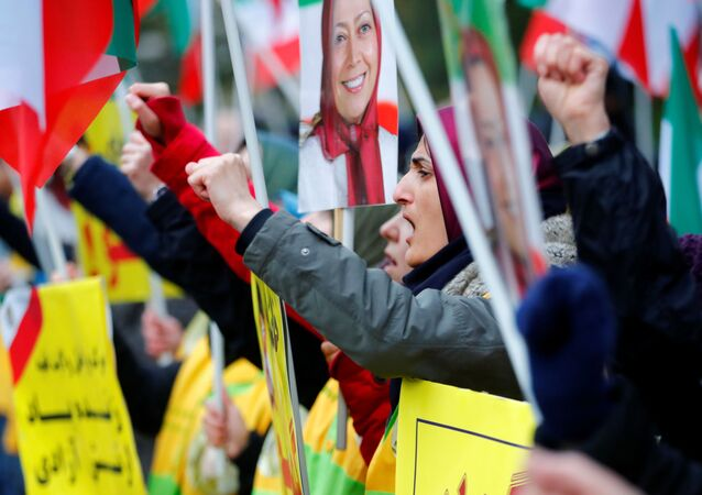 People attend a protest organised by National Council of Resistance of Iran in Germany to support nationwide demonstrations in Iran against the rise in gasoline prices, in Berlin, Germany, 17 November 2019