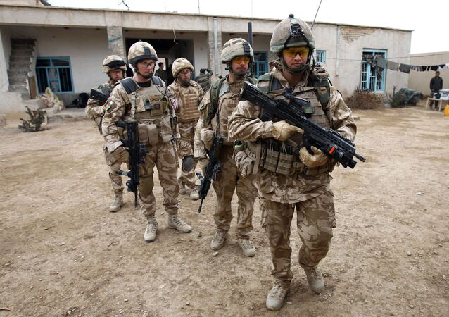 British soldiers of the 1st Batallion of the Royal Welsh before a patrol in the streets of Showal in Nad-e-Ali district, Southern Afghanistan, in Helmand Province on February 25, 2010