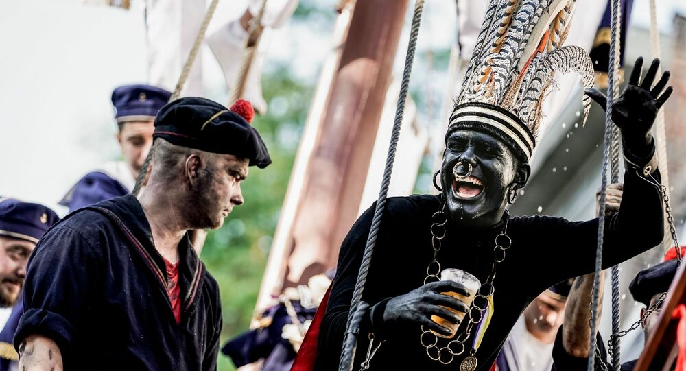 A man wearing a controversial makeup colouring blackface and called the savage gestures during a folk parade Ducasse of Ath in Ath, Belgium on August 25, 2019