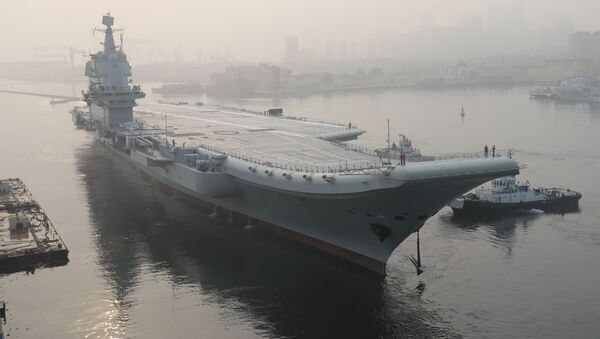 (FILES) In this file photo taken on May 13, 2018, China's first domestically manufactured aircraft carrier, known only as Type 001A, leaves port in the northeastern city of Dalian - Sputnik International