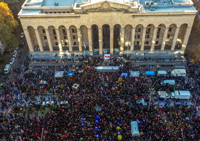 This picture taken on November 17, 2019 shows an aerial view of a crowd of Georgian opposition supporters gathered outside the parliament of Georgia in central Tbilisi, to demand the government's resignation and early parliamentary polls.