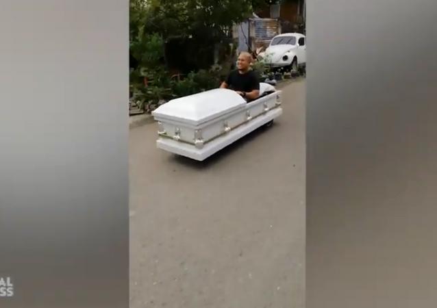Creative Motorist Drives 'Coffin-Mobile' Through Philippines