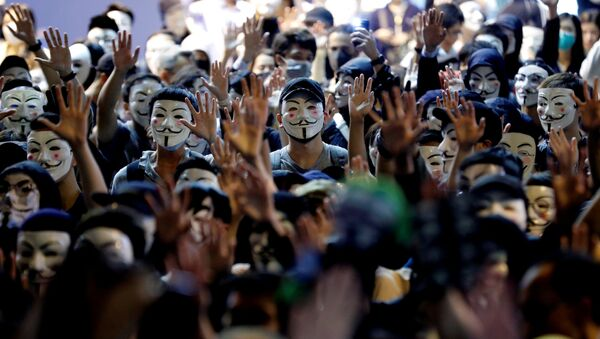 Protesters wearing Guy Fawkes masks attend an anti-government demonstration in Hong Kong, China, November 5, 2019 - Sputnik International