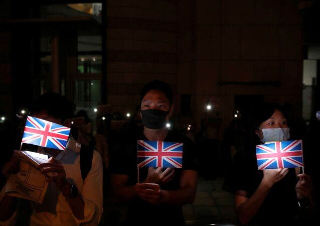 Anti-government demonstrators hold Union Jack flags as they protest in front of the UK consulate in Hong Kong, China, October 23, 2019